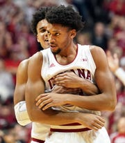 Jerome Hunter gets a hug from Justin Smith during last week's Maryland game, in which Hunter scored 12 points.