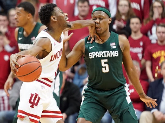 Indiana Hoosiers guard Al Durham (1) hits Michigan State Spartans guard Cassius Winston (5) in the face while dribbling during the game against Michigan State at Simon Skjodt Assembly Hall in Bloomington, Ind., on Thursday, Jan. 23, 2020.