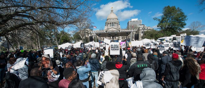 Hundreds of people gather on Mississippi Street at Capitol Street Friday, Jan. 24, 2020, for a rally protesting inhumane treatment at Mississippi Prisons. The rally was hosted by Yo Gotti and Team Roc after news of multiple deaths of Mississippi prisoners and conditions at Parchman prison made national news.