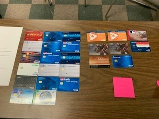 Fraudulent credit cards seized by Madison Police Department in alleged ID and car theft  case.