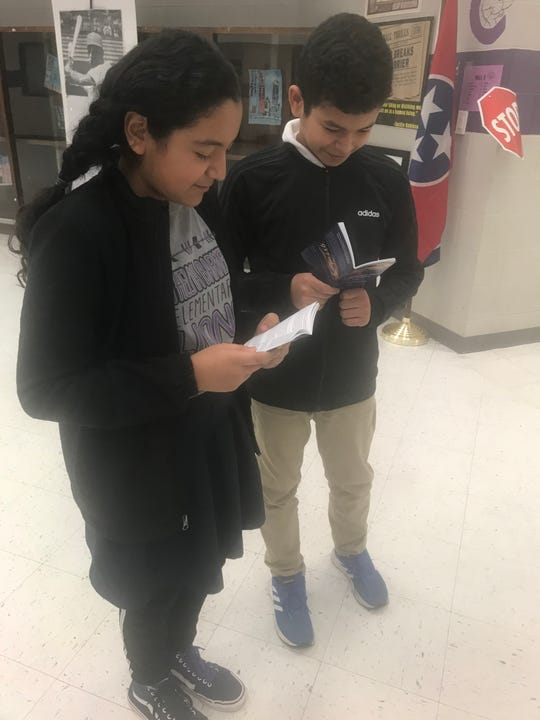 Thelma Barker fifth graders Jocelyn Maciel and Ali Osman look at their copies of the Constitution.