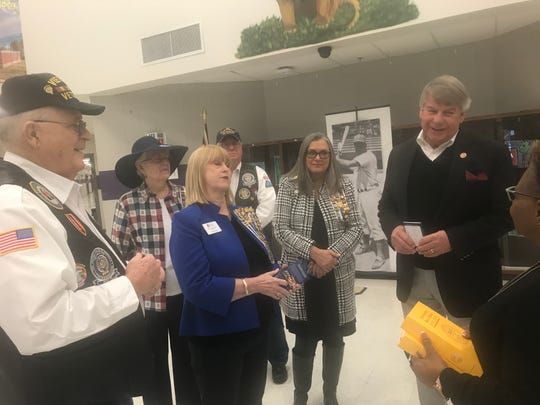 State Sen. Ed Jackson, far right, Daughters of the American Revolution's Jackie Utley, center, Vietnam Veterans of America's Bennie Benton, far left, and others from both groups talk about how much students at Thelma Barker Elementary have learned about the Constitution before fifth grade after Jackson presented pocket-size copies of the document to students at the school.