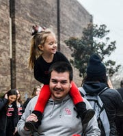 Knoxville Central Bobcats defensive coordinator Nick Craney with daughter Lilly, during the pep rally on Dec. 6, 2019, at Central High School, Knoxville.