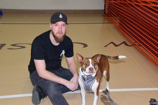 "Anthony McDaneld with Ledger the Boston Terrier at the second annual Paw Party held at West Towne Christian Church on Saturday, Jan. 18. ""He's a little dog, but a big dog at heart,"" said McDaneld. 2020"