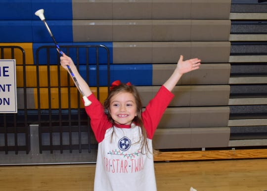 AnnaJo Ibbotson, 5, strikes a pose at the majorette workshop held at Karns High School Monday, Jan. 20.