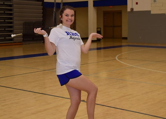 Macy McBee, 18, is pleased to have caught her baton after a particularly high toss at the majorette workshop held at Karns High School Monday, Jan. 20.
