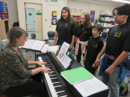 Teacher Edie Taylor plays the keyboard while a few of the members of the Cedar Bluff Middle School's vocal ensemble choir practice on Jan. 22, 2020, From left are Noor Alsaadun, Ari Rathe, Solomon Murakami, and Allan Rodriguez.