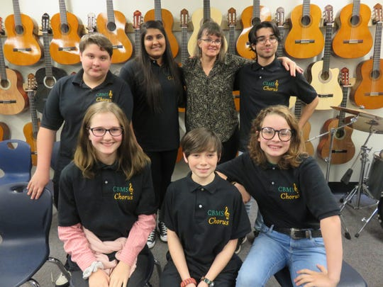 Several members of the Cedar Bluff Middle School's vocal ensemble relax in their classroom on Jan. 22, 2020. Front row, from left, are Ari Rathe, Solomon Murakami and Kate Crass. Back row: Ian Beatty, Noor Alsaadun, teacher Edie Taylor, and Allan Rodriguez.