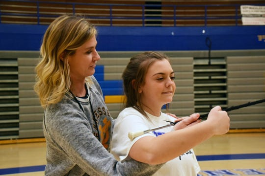 Instructional coach Karyn Lee helps Belle Whitson, 15, with follow through at the majorette workshop held at Karns High School Monday, Jan. 20.