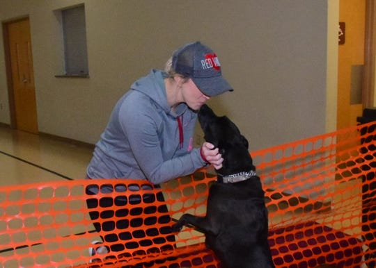 Rocky the Lab mix gives his owner Katy Ramey a kiss at the second annual Paw Party held at West Towne Christian Church Saturday, Jan. 18.