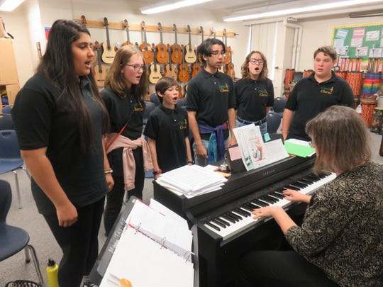 Six members of Cedar Bluff Middle School's vocal ensemble practice at the school on Jan. 22, 2020, while teacher Edie Taylor leads them on the keyboard. From left are Noor Alsaadun, Ari Rathe, Solomon Murakami, Allan Rodriguez, Kate Crass and Ian Beatty. The group performed at the Mighty Musical Monday program at the Tennessee Theatre in December.