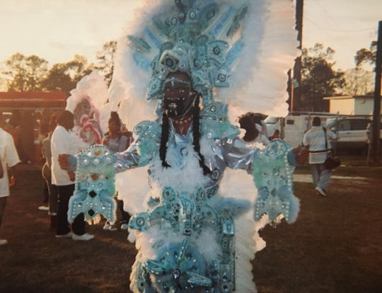 Alton Armstrong returned to Lafayette to find most of his friends had adopted the New Orleans Mardi Gras Indians garb, as opposed to the traditional outfits he grew up with. In this image, Armstrong was still combining the two worlds: a traditional mask with the larger than life Indian outfit.