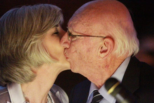 Harry Griffith, the Howell Area Chamber of Commerce 2019 Citizen of the Year, gets a congratulatory kiss from his daughter, Carol Griffith, the 2018 Citizen of the Year, who announced the honor at the chamber's annual awards dinner at Crystal Gardens Thursday, Jan. 23, 2020.
