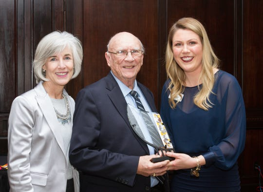 Harry Griffith receives the Howell Area Chamber of Commerce 2019 Citizen of the Year Award, presented to him by his daughter, Carol Griffith, left, the 2018 Citizen of the Year, and chamber President Janelle Best at the chamber's annual awards dinner at Crystal Gardens Thursday, Jan. 23, 2020.