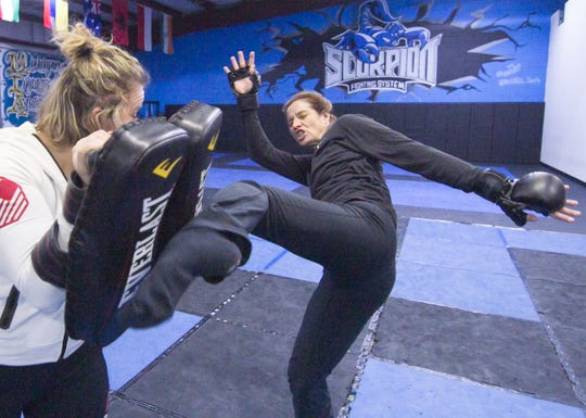 Heidi Miller, right, puts in some pad work training with trainer Amanda Bobby Cooper-Brundage at Michigan Institute of Athletics in Genoa Township Wednesday, Jan. 22, 2020. Miller will be making her mixed martial arts fight debut on Feb. 8 against Haley Nienhuis at Lights Out Championship 7 at the DeltaPlex Arena and Conference Center in Walker.