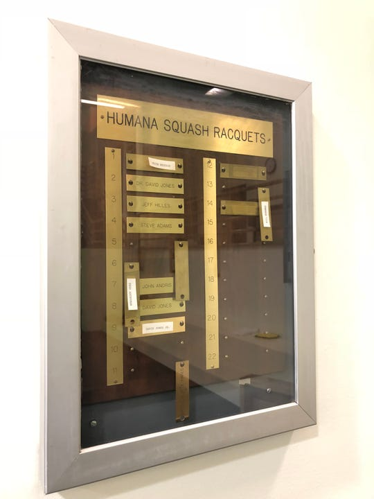 """The name """"David Jones"""" can still be read on an outdated ranking plaque in Humana's basement squash facility."""