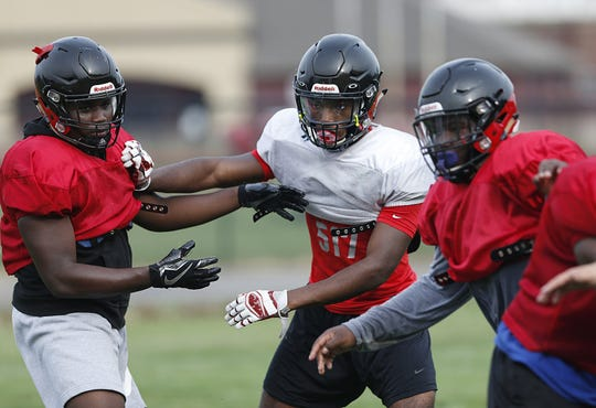 Groveport Madison High School football player Jasiyah Robinson, center, shown at football practice at the school on Tuesday, August 20, 2019.