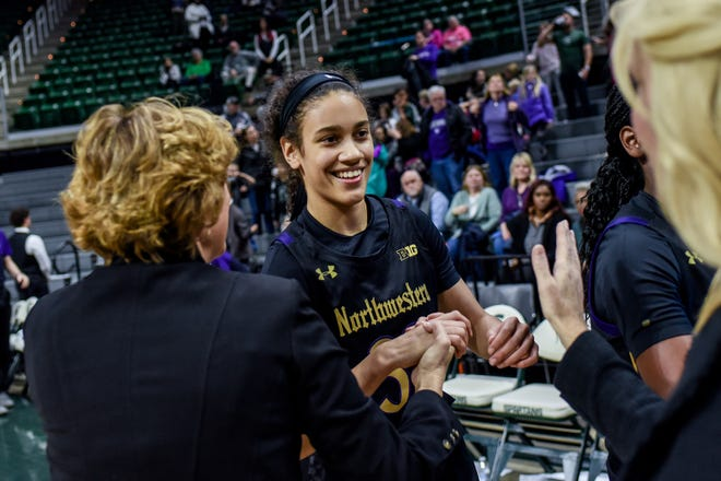 Northwestern's Laya Hartman, center, shakes hands with Michigan State associate coach Maria Fantanarosa, left, and head coach Suzy Merchant after the game on Thursday, Jan. 23, 2020, at the Breslin Center in East Lansing. Hartman played high school basketball at Okemos High School.