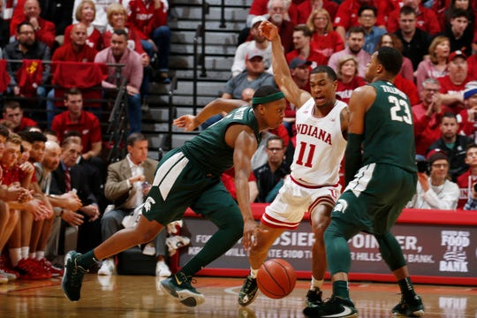 Jan 23, 2020; Bloomington, Indiana, USA; Michigan State Spartans guard Cassius Winston (5) drives to the basket against Indiana Hoosiers guard Devonte Green during the first half at Simon Skjodt Assembly Hall. Mandatory Credit: Brian Spurlock-USA TODAY Sports
