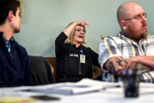 Lansing Police Department social worker Jan Bidwell, center, speaks during a planning meeting at Advent House Ministries on Thursday, Jan. 23, 2020, for a Point in Time count of the number of people who are homeless in Lansing. Bidwell is the first police department staff social worker in the state, city officials said.