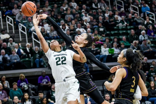Michigan State's Moira Joiner, left, is blocked by Northwestern's Veronica Burton during the second quarter on Thursday, Jan. 23, 2020, at the Breslin Center in East Lansing.