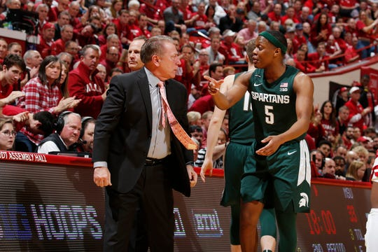 Jan 23, 2020; Bloomington, Indiana, USA; Michigan State Spartans guard Cassius Winston (5) talks to coach Tom Izzo in a game against the Indiana Hoosiers during the second half at Simon Skjodt Assembly Hall. Mandatory Credit: Brian Spurlock-USA TODAY Sports