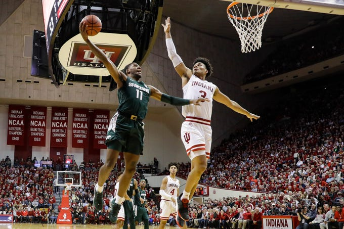 Michigan State forward Aaron Henry (11) shoots over Indiana forward Justin Smith (3) in the second half of an NCAA college basketball game in Bloomington, Ind., Thursday, Jan. 23, 2020. (AP Photo/Darron Cummings)