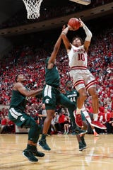Jan 23, 2020; Bloomington, Indiana, USA; Indiana Hoosiers guard Rob Phinisee (10) takes a shot against Michigan State Spartans guard Cassius Winston (5) during the first quarter at Simon Skjodt Assembly Hall. Mandatory Credit: Brian Spurlock-USA TODAY Sports