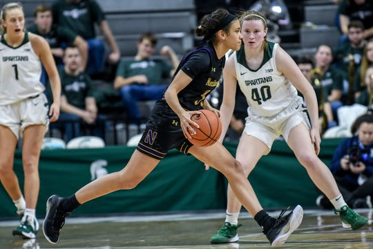 Northwestern's Laya Hartman moves with the ball during the fourth quarter on Thursday, Jan. 23, 2020, at the Breslin Center in East Lansing. Hartman played high school basketball at Okemos.