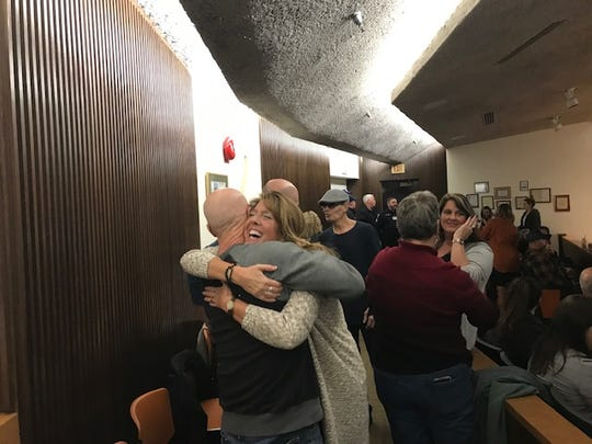 Retiring City of Mansfield 911 dispatcher Suzanne Meister hugs retired Mansfield police officer John Fuller at her retirement farewell reception at city hall.