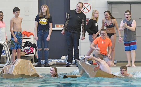 Both boats immediately took on water Friday during the finals of the Hillsdale Middle School cardboard boat races.