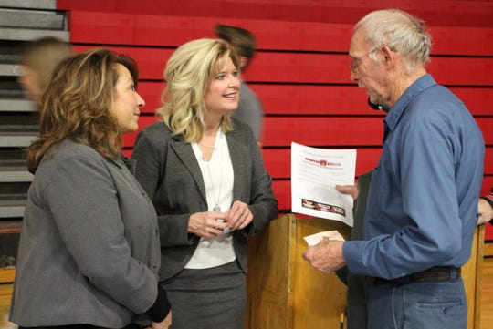 Pleasant Local Schools Board of Education member Annette Holler, left, and Superintendent Jennifer Adams, center, talk with a community resident following the district's state of the schools event on Thursday.