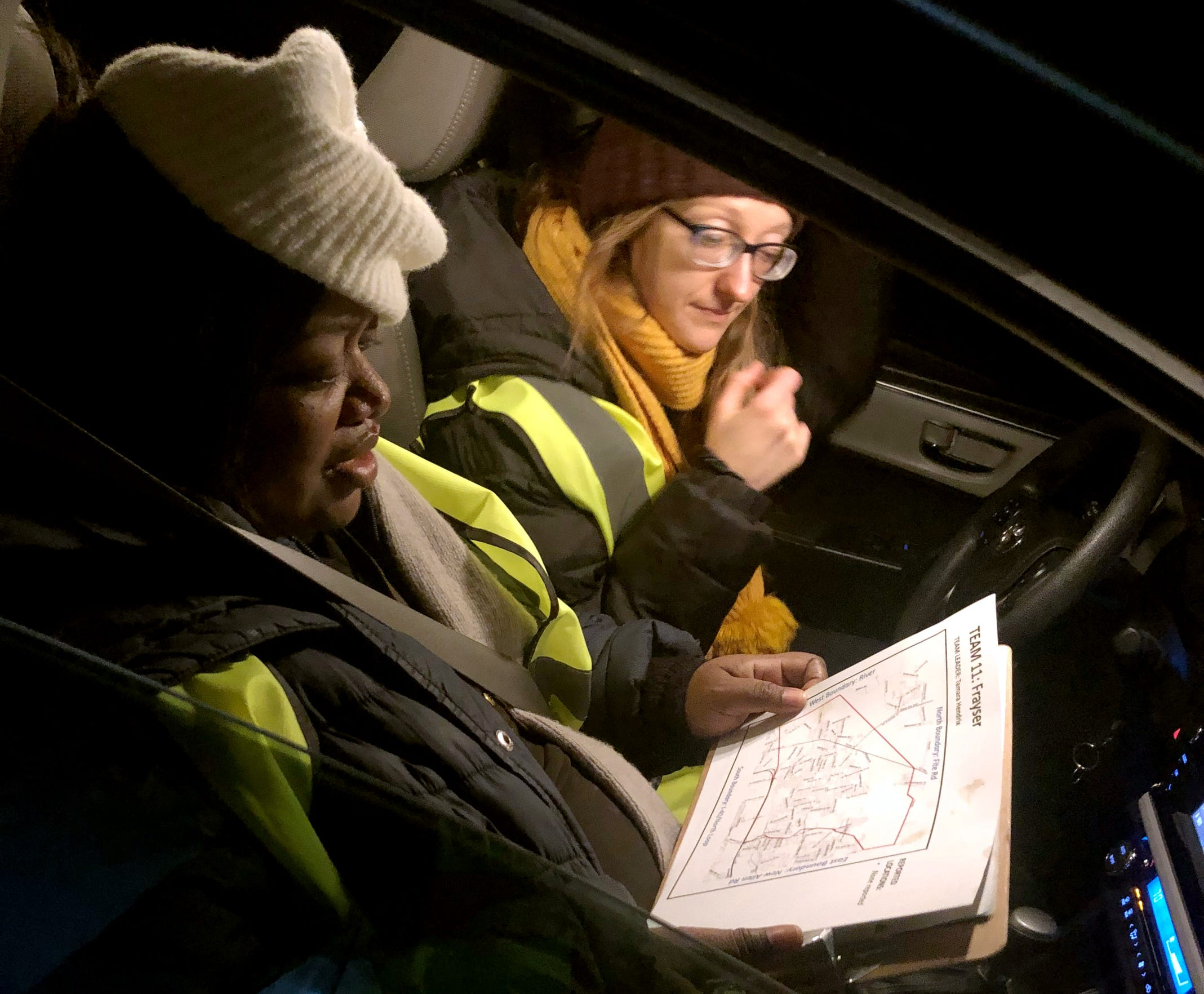 Tamara Hendrix and Ellen Paddock review a map of Frayser, their assigned area, while conducting the Point-In-Time count on January 22, 2020.