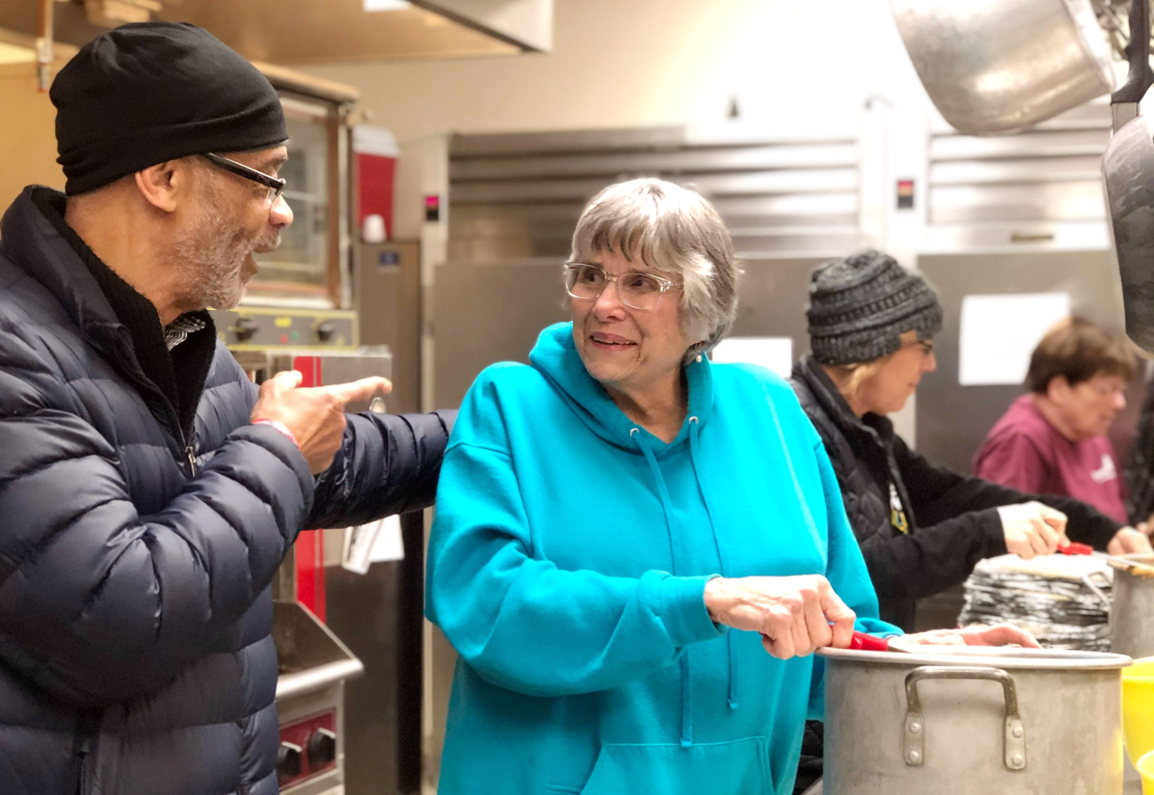 First United Methodist Church volunteers talk during their weekly burrito assembly line. In addition to providing a Room in the Inn with a space for their 'holy hospitality' operation, the church hands out food to those in need every Tuesday.