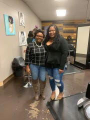 Jazmyne Wright, left, visits Takeisha Berry-Brooks at her salon, A Natural Affair.