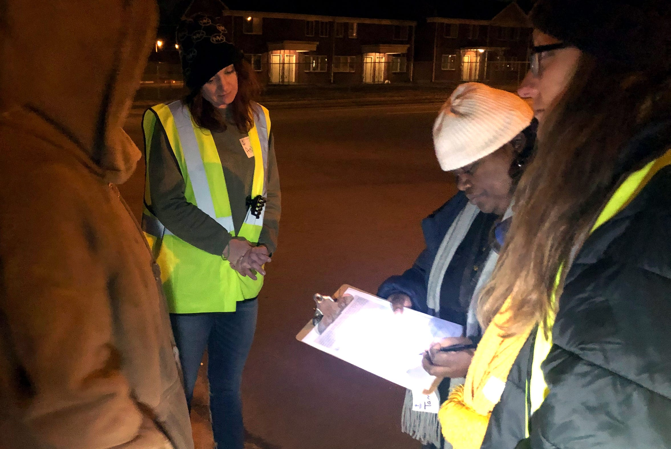 Point-In-Time count volunteers collect a survey in Frayser just before 6 a.m. on January 22, 2020.