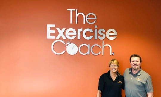 Rick and Brenda Frembgen stand in their new Exercise Coach studio at 255 Schilling Blvd. in Collierville.