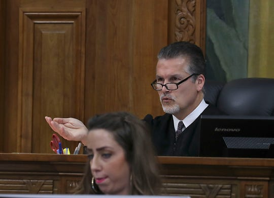 Wisconsin Circuit Judge Kevin Martens asks a question of attorney Matthew O'Neill  during the hearing.