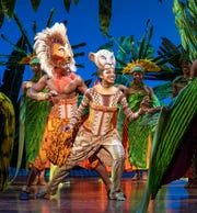 "Brandon A. McCall and Kayla Cyphers portray Simba and Nala in the North American tour of Disney's ""The Lion King."""