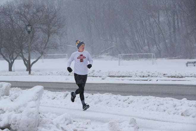 Cal Papineau, a Marquette University student, had to watch his footing on the slick sidewalks as he ran along Milwaukee's lakefront along North Lincoln Memorial Drive.