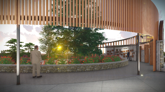 The inside of the gateway feature would provide opportunities for guests to sit down and enjoy the views of flowers, trees and the Milwaukee River.