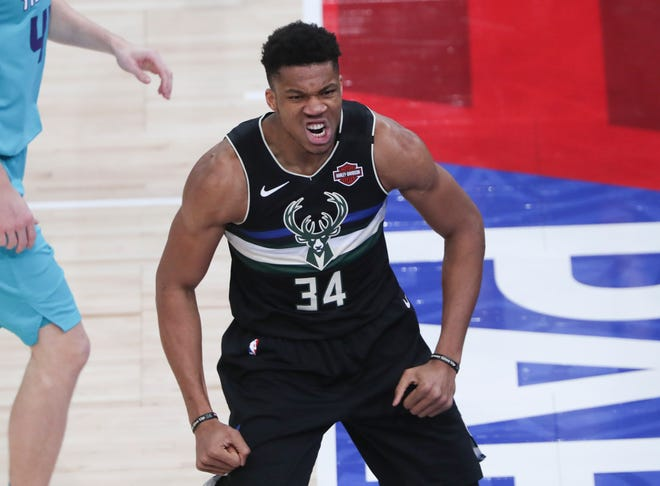 Bucks forward Giannis Antetokounmpo brings out the mean mug after hammering home a dunk against the Hornets.
