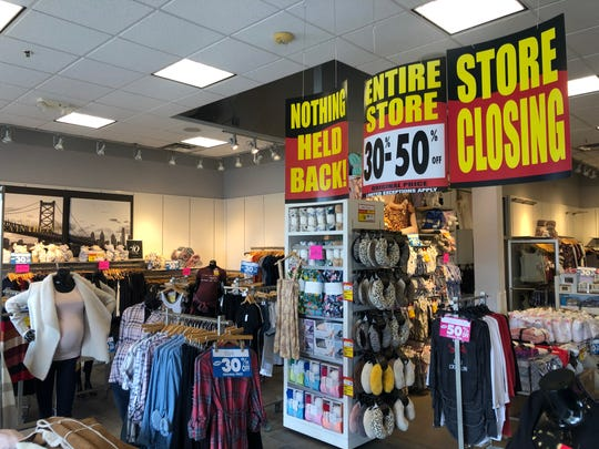 A store closing sale at Destination Maternity announced sales of 30 to 50 percent off all items.