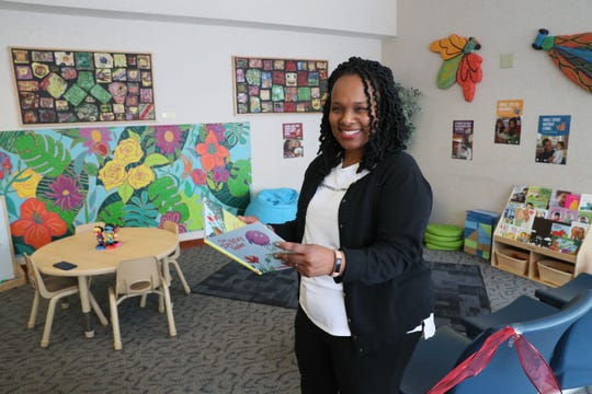 Dea Wright, director for the City of Milwaukee Office of Early Childhood Initiatives, stands in the waiting area at the court facility that was redone to stimulate childhood learning.