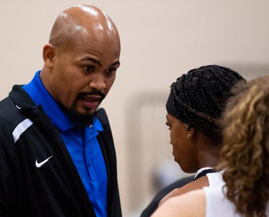 Marbury coach Reginald Brown talks with his daughter Marbury's Renijah Brown (3) during a timeout against Brewbaker Tech on the Marbury campus in Marbury, Ala., on Thursday January 23, 2020.
