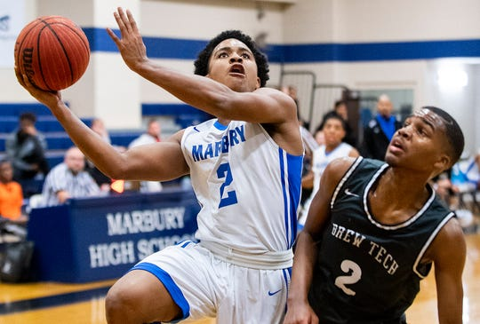 Marbury's Zamari Brown (2) shoots against Brewbaker Tech's Justin Johnson (2) on the Marbury campus in Marbury, Ala., on Thursday January 23, 2020.