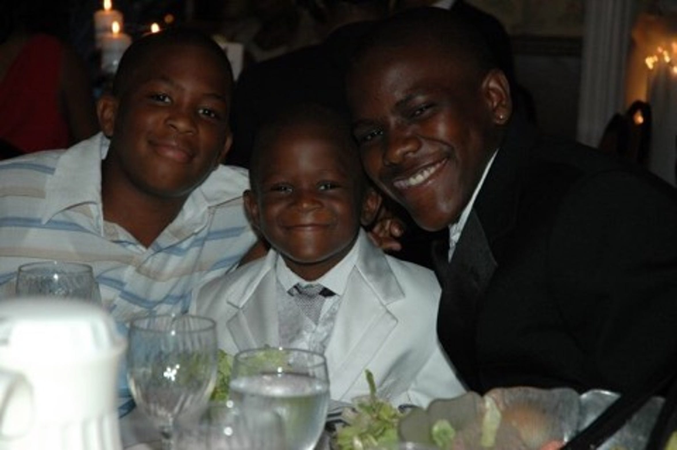 A young Frank (right), Christian (left) and Zavier Clark (middle) pose for a photo at their Uncle Shaun and Aunt Gina Bryant's wedding.