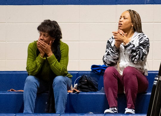 Yvette Brown, right, watches her husband coach her children at the Marbury High Schoolcampus in Marbury, Ala., on Thursday January 23, 2020.