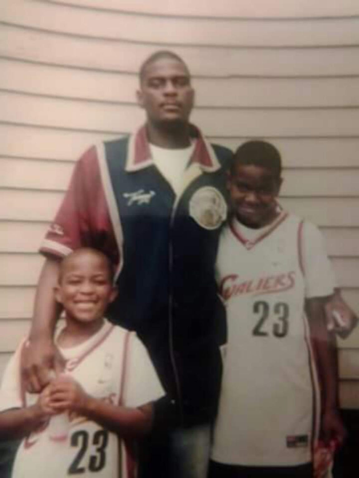 Frank (right) and Christian (left) pose with their father Frank Clark III in matching LeBron James jerseys.