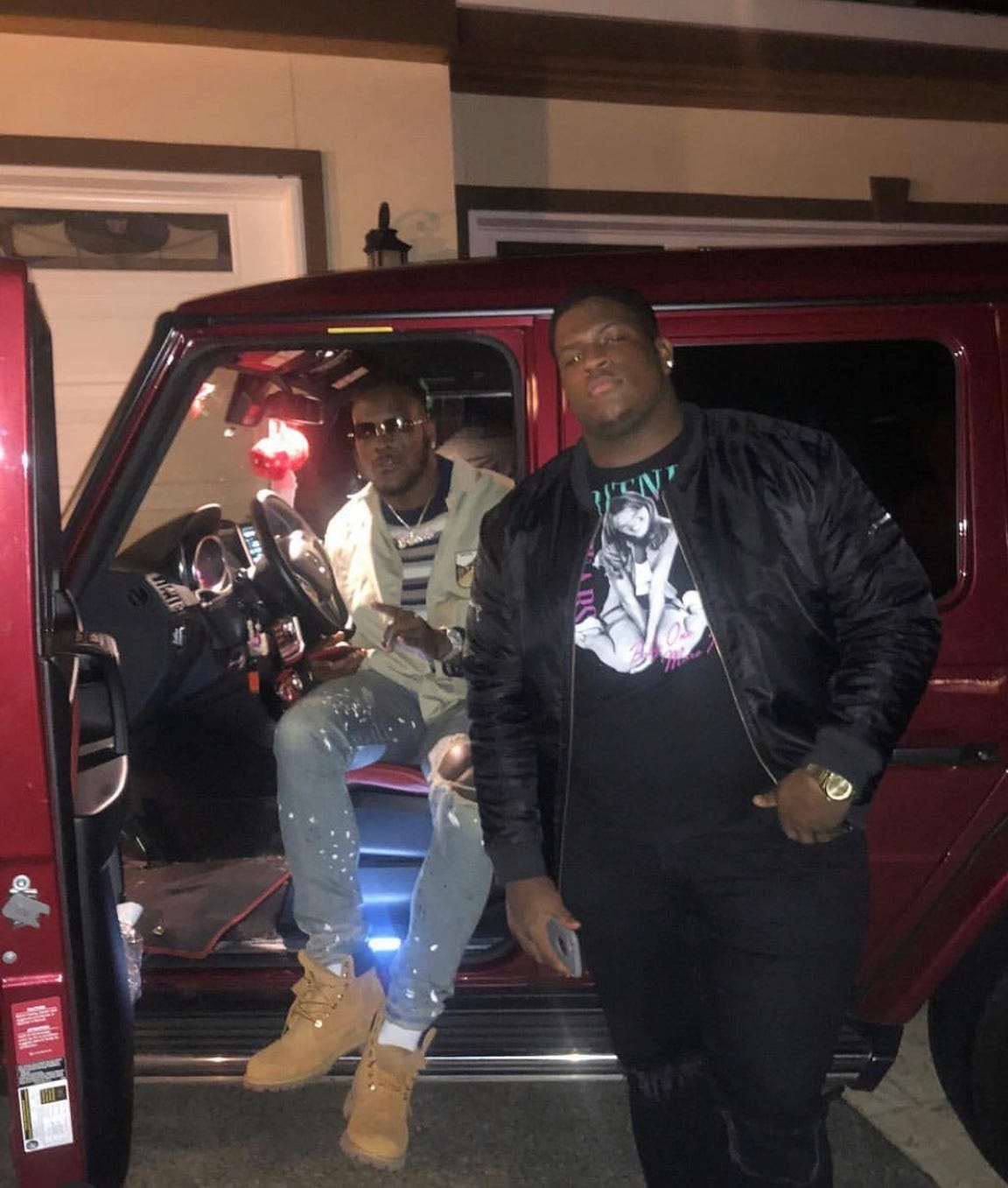 Frank and Christian Clark take a photo in front of Frank's Mercedes-Benz G-Class truck (G-Wagon).